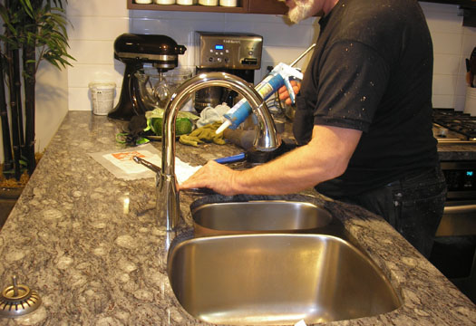 Handyman in Vancouver performing sink repairs.